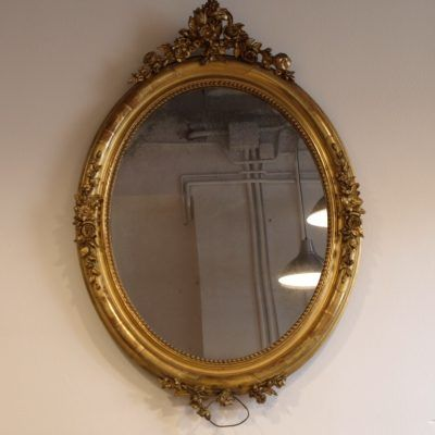 GOLDEN OVAL MIRROR WITH GOLD LEAF